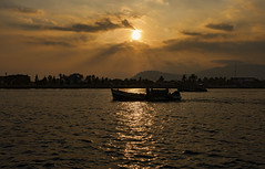 Golden Kampot (ORIONSM) Tags: kampot boat sunset golden river cruise water cambodia asia silhouette bokor mountains clouds rays sony rx100mk3