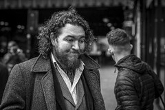 The Sun Will Come Out Tomorrow (Leanne Boulton) Tags: portrait urban street candid portraiture streetphotography candidstreetphotography candidportrait streetportrait streetlife man male face expression eyes happy happiness smile smiling emotion mood feeling curly hair beard moustache cravat style fashion tone texture detail depthoffield bokeh naturallight outdoor light shade city scene human life living humanity society culture people canon canon5d 5dmkiii 70mm ef2470mmf28liiusm black white blackwhite bw mono blackandwhite monochrome glasgow scotland uk