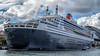 That's a big boat... (Eddy Summers) Tags: queenmary2 boat ship huge humongous gigantic cruise cruiseship sydney circularquay harbourbridge topaz pentaxk1 fa50mm14