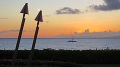 A Maui Tiki Sunset (PDX Bailey) Tags: hawaii maui sunset water ocean sky boat sail sailboat tiki fire gold yellow orange sun set cloud beach coast