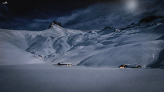 In the pale moonlight (VandenBerge Photography (Back again!)) Tags: nature nationalgeographic night dark moonlight clouds sky switzerland season snow snowscape blue berneseoberland engstligenalp lonelyplanet lights mountains peaks cold canon cantonberne adelboden tschingellochtighorn houses plateau