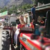 Chinese Girl driving Tracktor (tourguidance_pk) Tags: travel tourism history chinese guest explore pakistan visitpakistan hunza gilgit skardu mountains food tradition cultures folk company blossoms nature baltistan festivals