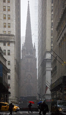 Downtown - New York City (emmett.hume) Tags: snow umbrella church city newyorkcity manhattan cavern urban 1025fav trinitychurch wallstreet landmark