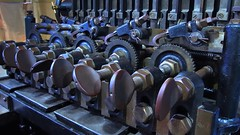 Textile machinery ratchets and pawls - Museum of Science and Industry, Manchester, England. (edk7) Tags: olympusomdem5 edk7 2017 uk england lancashire greatermanchester manchester manchesterm3 liverpoolroad museumofscienceandindustry msi textilemachineryratchetsandpawls metal museum relic artefact artifact industrial mechanical machine symmetry thumbscrew