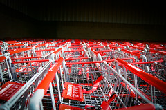 carts galore (janette_j) Tags: red carts shopping market nikon n65 ektar 100