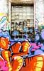 Graffiti Window (Karen_Chappell) Tags: graffiti window downtown urban city stjohns color colourful colours brick architecture building paint painted glass orange blue pink purple yellow grey newfoundland nfld broken