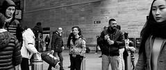 Slice of life. (Baz 120) Tags: candid candidstreet candidportrait city candidface candidphotography contrast street streetphoto streetphotography streetcandid streetportrait sony a7 fullframe rome roma romepeople europe women monochrome mono monotone noiretblanc bw blackandwhite urban vivitar28mmf2 life primelens portrait people italy italia grittystreetphotography decisivemoment faces strangers
