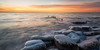 Ice Rocks (David Colombo Photography) Tags: milwaukee wisconsin lake lakemichigan winter cold ice icy frozen dawn morning sunrise orange blue water waves pier pylons pilings clouds davidcolombo davidcolombophotography nikon d800