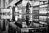 XXANAXX 191.365 (ewitsoe) Tags: monochrome blackandwhite bnw bike ride rider man reflection city cityscape urban billboards fence walk ewitsoe canon 6dii street ecplore travel race water puddle sidewalk riding