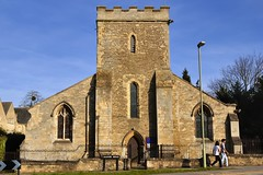 Church of St Cross in Holywell, 9thC through 19thC, Oxford, England. (edk7) Tags: nikond50 edk7 2007 uk england oxfordshire oxford manorroad stcrosschurch churchofstcrossinholywell structure12thc originaltower13thc towerrebuilt1464 aisles19thc gradeilisted crenelations battlements tower stone aisle gothicrevivalwindow architecture building oldstructure city cityscape urban historic buttress fence road sidewalk person people sky stonework gargoyle belfry