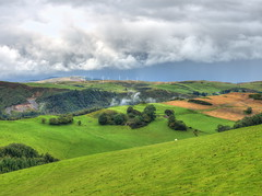 The wide vistas of Wales (Digidoc2) Tags: ruralscene fields landscape hills countryside meadows scenery scenic mountainrange valley rollinglandscape pasture windturbines forests sky clouds sheep green grass wales