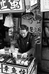 Dr. Octopus (Go-tea 郭天) Tags: xiamen cook fried fritters octopus candid portrait man shop business cooking food busy duty alone sell seller selling filled filling sea street urban city outside outdoor people bw bnw black white blackwhite blackandwhite monochrome naturallight natural light asia asian china chinese canon eos 100d 24mm prime warm hot xiamenshi fujiansheng chine cn
