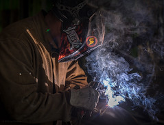 Molten (Lisa Ouellette) Tags: welding construction iron pipe castiron leather sparks smoke flame filigree tendrils pipefitters plumbers hood