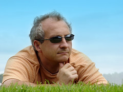 Michel Bernard (michelbernard786) Tags: man men male father dad sunglasses deep glasses shades lying depressed contemplating loss mourning glad good mood young mature older resting enjoying looking thinking vacation green aging gray hair balding people background faces portrait friendly casual ordinary cool white blue sky weekend attractive dude guys sunny days middleaged michel bernard