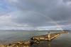 Pier and rainbow (Massimo_Discepoli) Tags: lake rainbow pier trasimeno beautiful water clouds rain surreal