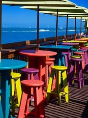 A Vivid Afternoon (Professor Bop) Tags: keywestflorida color vivid olympusem1 professorbop drjazz restaurant deck chairs tables