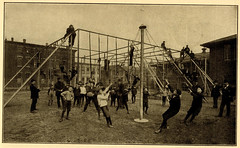 [Boys on maypole swing and climbing jungle gym ladders on playground] (State Library of Massachusetts) Tags: children playground swings maypoleswing junglegym ladders