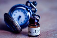 Down the Rabbit Hole (Eric Tischler) Tags: macromondays onceuponatime alice wonderland potion clock watch