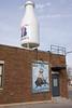 interesting poster- mural (WORLDS APART PHOTO) Tags: braums braumsoklahomasmilk route66 advertising milk milkbottle mural poster triangularshapedbuilding wherethethunderrolls bison oklahomacity
