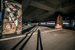 Completely engaged (Melissa Maples) Tags: münchen munich deutschland germany europe nikon d3300 ニコン 尼康 sigma hsm 1020mm f456 1020mmf456 winter graffiti streetart art shadow me melissa maples selfportrait woman streetartgallery donnersbergerbrücke woodland