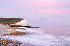 The Seven Sisters (LongLensPhotography.co.uk - Daugirdas Tomas Racys) Tags: sevensisters seven sisters coast coastal coastline shore beach pebbles waves wave sea englishchannel england whitecliffs sunset dusk evening glow pink light nature landscape seascape uk britain licensing license prints available longlensphotography fineart fineartlandscape