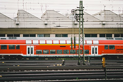 Lost in GB (Thomas Listl) Tags: thomaslistl color film filmphotography analog minoltax700 kodak portra160 135mm train urban würzburg grombühl hiphop instrumental red railway music db