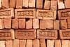 The Brick Pile (gooey_lewy) Tags: bricks mahan layout artistic pile colour symmetrical orange house india indian work brick uk