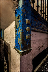 Peeling paint (ronnymariano) Tags: 2018 theater lansdowne abandonded iron railing peeling old bannister fastener bolt paint blue abandoned colors corner color