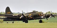 Boeing/Vega B-17G-105-VE Flying Fortress heavy bomber, 1945 - Duxford Aerodrome, England.. (edk7) Tags: nikond300 edk7 2010 uk england cambridgeshire duxford duxfordaerodromeqfoegsu imperialwarmuseum iwm b17charitabletrust boeingb17g105veflyingfortress burbankcalif1945 lockheedvegacn8693 unitedstatesarmyairforces usaafsn4485784 dfa gbedf fourengine heavy bomber secondworldwar worldwartwo worldwarii worldwar2 wwii ww2 propellor propeller plane airplane military warplane aviation aircraft wrightr182097cyclone9turbosuperchargedradial1200hp cloud sky chinturret machinegun perspex nose cockpit antenna pinupgirlnoseart nickname word