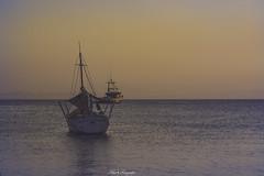 Two ships...!!! (Nita_Fotos) Tags: sun sundown clouds blue orange sol atardecer nubes naranja cielo barcos botes ships lecheria venezuela tuniñasalvajedelaselva