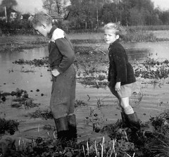 Floods (theirhistory) Tags: boys children kids field water shorts trousers jacket wellies rubberboots grass girl
