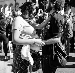 feeling the future (gguillaumee) Tags: film analog grain square rolleiflex mediumformat bw blackandwhite street streetphotography couple love pregancy womensmarch losangeles america usa fujineopanacros 100iso close candid