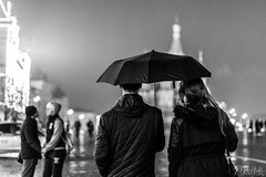 Under My Umbrella (D. R. Hill Photography) Tags: moscow russia redsquare night street streetphotography umbrella couple rain blackandwhite monochrome nikon nikond7100 d7100 50mm nikon50mmf14g primelens fixedfocallength