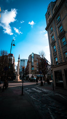 Sunny day in Seven Dials (Elliot Bick) Tags: london uk england europe sony alpha sonyalpha alphaseries a7rii colour color light sun sunny spring buidling city urban cityscape urbanscape blue zeiss architecture road people commute taxi black cab sevendials