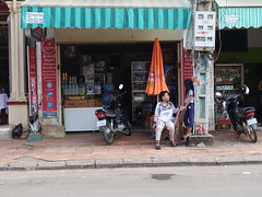 Good friends (D70) Tags: boy girl talking siem reap province cambodia electricity meter umbella street scene children store shop sony dscrx100m5 ƒ40 189mm 180 125 cooler display sweet joe chatting friend