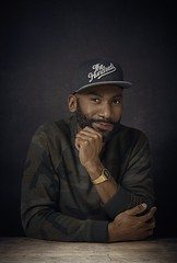 Classic Look (Chris ND) Tags: portrait male black boy montreal table eye portraiture profoto b1 hundreds outfit face wear skin retouch wooden bois montre watch regard paris capture one noir backdrop