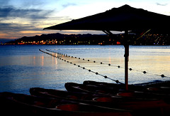 Central beach in Eilat at sunset. (rel-tour) Tags: beauty in nature eilat beach sea central light calm photography tranquil scene thatched roof sky boat israel