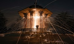 Don't blame it on the moonlight (singulartalent) Tags: claphamcommon jaymathewson markhigham philcreswick bandstand flame light london moonlight orb sparks spin spinning uk wirewool
