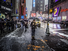 Cold Rain, Snow and Cell Phone (C@mera M@n) Tags: city manhattan ny nyc newyork newyorkcity newyorkcityphotography newyorkphotography people place places rain snow snowstorm storm timessquare urban outdoors