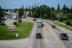 View from the Skywalk (Vegan Butterfly) Tags: outside outdoor dryden ontario town urban road traffic vehicles truck trucks cars car art gallery carpet store buildings community