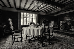 The Dining Room at Packwood House (Holfo) Tags: nationaltrust england packwoodhouse warwickshire diningroom chairs window monochrome nikon d750 old room folds tablecloth faded bygone carpet cloth beams blackandwhite bw wicker leadedwindow