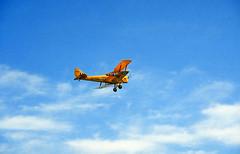 "6 March 1993 - de Havilland ""Tiger Moth"" A17-666 flying over Langley Park, Perth, Western Australia (aussiejeff) Tags: langleypark flyin perth wa tigermoth biplane airshow aircraft airplane plane australia aviation historic vintage dehavilland a17666 vhbar saaa jeffc aussiejeff flickr raaf sky cloud sunny yellow sportsaircraft 90s"