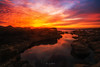 Crazy Sunset (Alex Apostolopoulos) Tags: dramatic longexposure rockformations sunset clouds fire red rocks sky