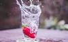 Splashing Fun!! (BGDL) Tags: lightroomcc nikond7000 bgdl afsnikkor50mm11 niftyfifty garden glassofwater strawberry splash waterwatereverywhere week9 saturdaytheme flickrlounge