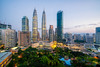 Cityscape of Kuala Lumpur Panorama at sunrise. Panoramic image of skyscraper at Kuala Lumpur, Malaysia skyline at dawn. (MongkolChuewong) Tags: 2018 architecture asia asian blue building business capital center city cityscape district downtown dusk evening famous home house kl klcc kuala landmark landscape lumpur malaysia malaysian modern night office panoramic petronas place reflection scene sky skyline skyscraper summer sunrise sunset technology tower towers travel traveler traveller twilight twin urban view