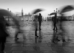 Venice - A Moment in Time (annemcgr) Tags: venice italy people movement slow motion blur motionblur blackwhite fineartphotography monochrome rain umbrella