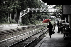 (cherco) Tags: woman umbrella myanmar train station rail wait red colour bridge travel anden platform mujer color composition composicion canon city ciudad