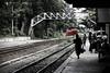 (cherco) Tags: woman umbrella myanmar train station rail wait red colour bridge travel anden platform mujer color composition composicion canon city ciudad