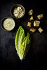 Vegan Caesar Salad (saraghedina) Tags: vegan salad lunch vegetarian healthy plantbaseddiet plantbasedfood croutons homemade dressing almonds nuts romaine lettucestilllife foodphotography foodstyling canon 50mm canon5dmarciv lemon darkbackground texture rustic crumble oliveoil verticalcomposition topdown citrus greens leaf