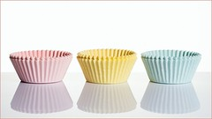 Paper Cups (Karen_Chappell) Tags: pastel pink white blue yellow paper cupcake reflection three 3 stilllife birthday